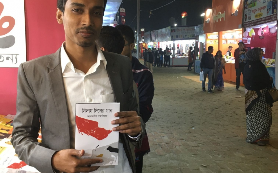Alomgir Shahriah showing his new book at the Dhaka Book Fair, Bangladesh, February 2020